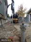 Installation of a Helical Screw Pile metal post foundation